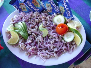 Tiritas, a traditional fisherman's dish. Throw your line off the side of your boat, catch a snapper, dorado or something similar. Cut into strips, toss with fresh onion and marinate for a few hours in lots of lime juice. If you have any on your boat, add a bit of salt to taste, garnish with avocado and serve with saltines or tortilla chips. Enjoy.