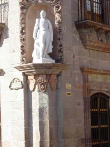 Ignacio Allende's statue keeps an eye on the festivities.